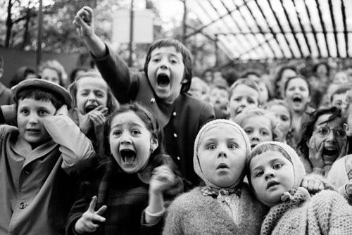 By Alfred Eisenstaedt taken in Paris 1963, for Life magazine. The children are watching a puppet show of St. George and the Dragon.